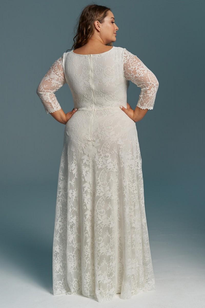 Elegancka, zabudowana suknia ślubna plus size z długim rękawem